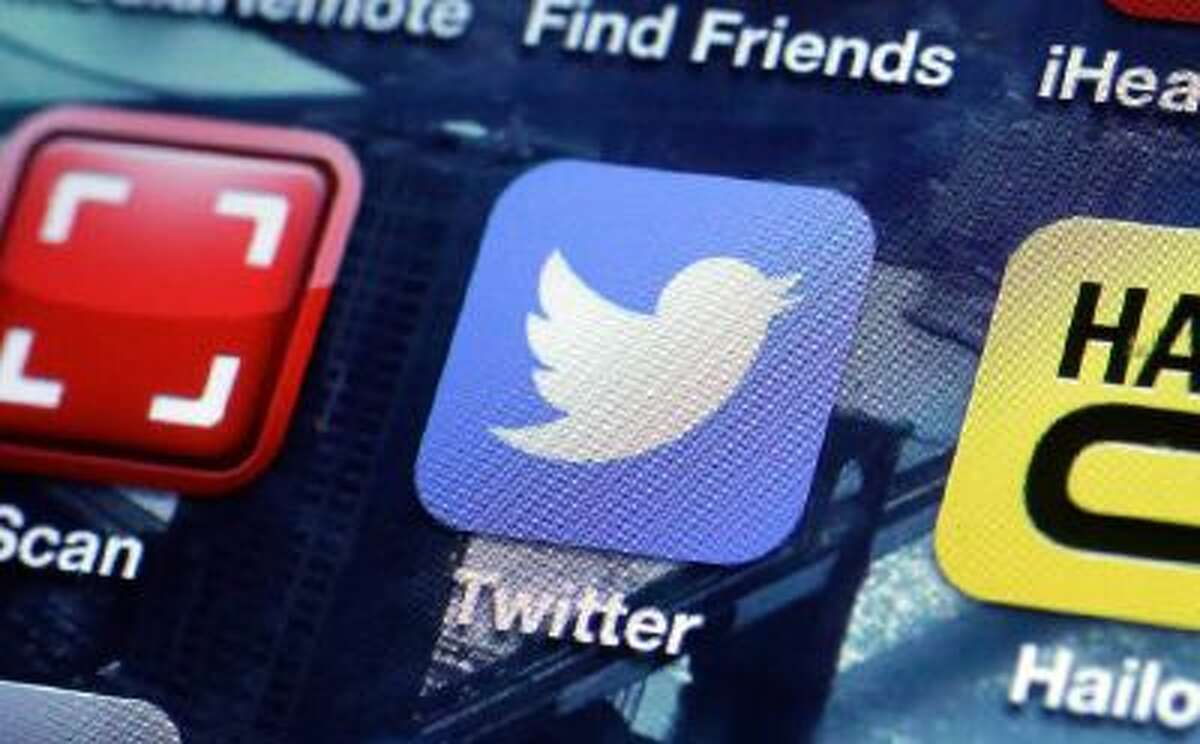 This Oct. 18, 2013 photo shows a Twitter app on an iPhone screen in New York.