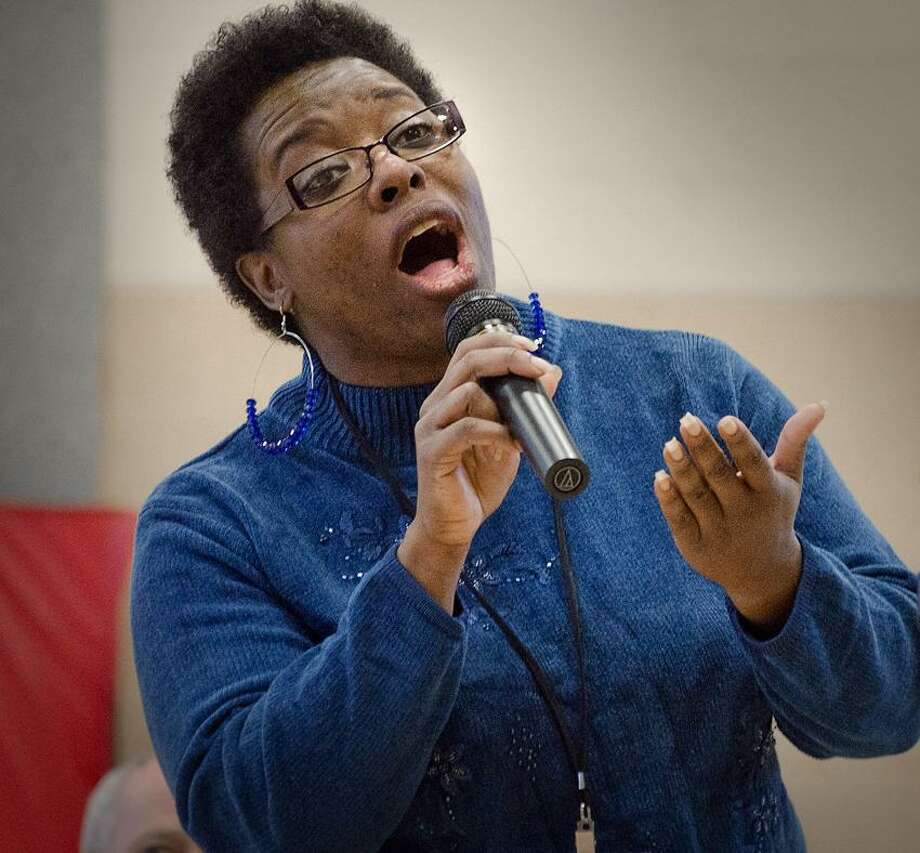 "ANSONIA-Mead Elementary School Lunch Aide, Eleanore Reeves, sings ""The Wind Beneath My Wings "" during MLK  community recognition ceremonies .    Melanie Stengel/Register"