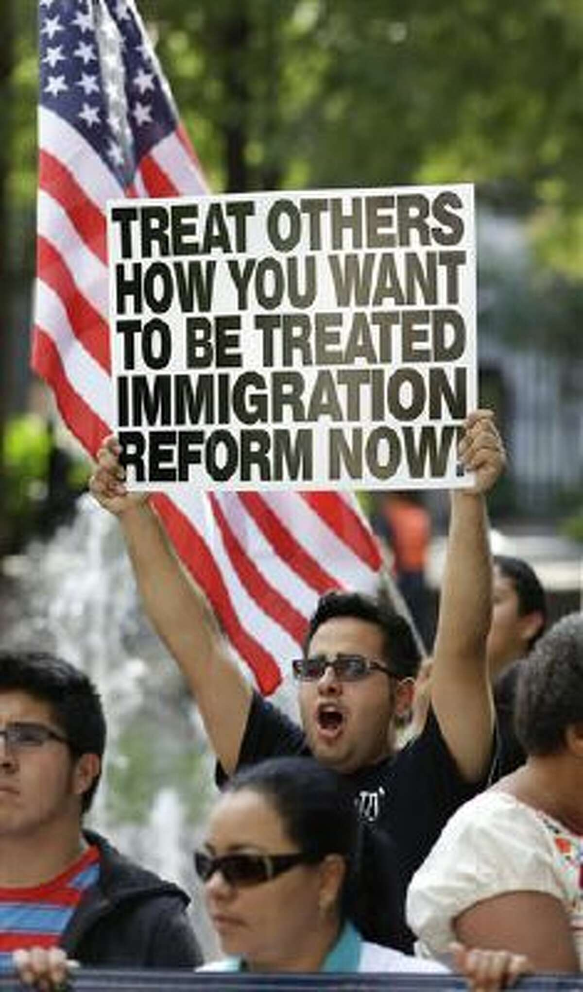 Immigration reform advocates march Tuesday in Orlando, Fla. The march and rally was to support passage of a pathway-to-citizenship bill for immigration reform.