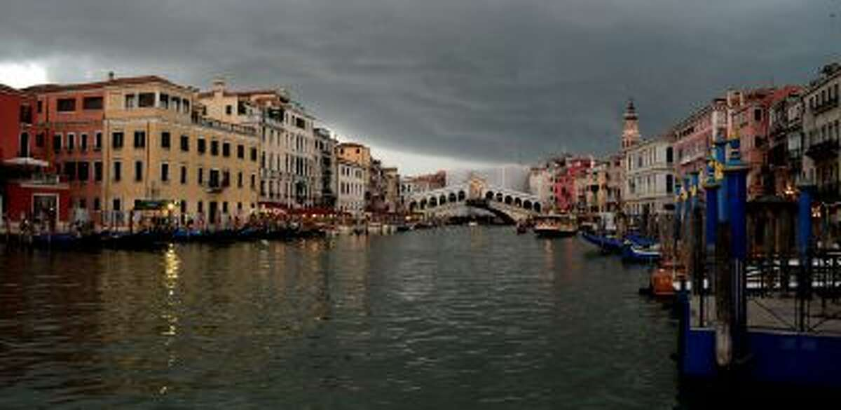 """The Rialto Bridge in Venice, Italy. A top maker of amusement park rides unveiled a controversial project Wednesday to transform a """"rubbish island"""" in Venice into a cultural attraction, insisting the floating city would not be blemished by a fun park."""