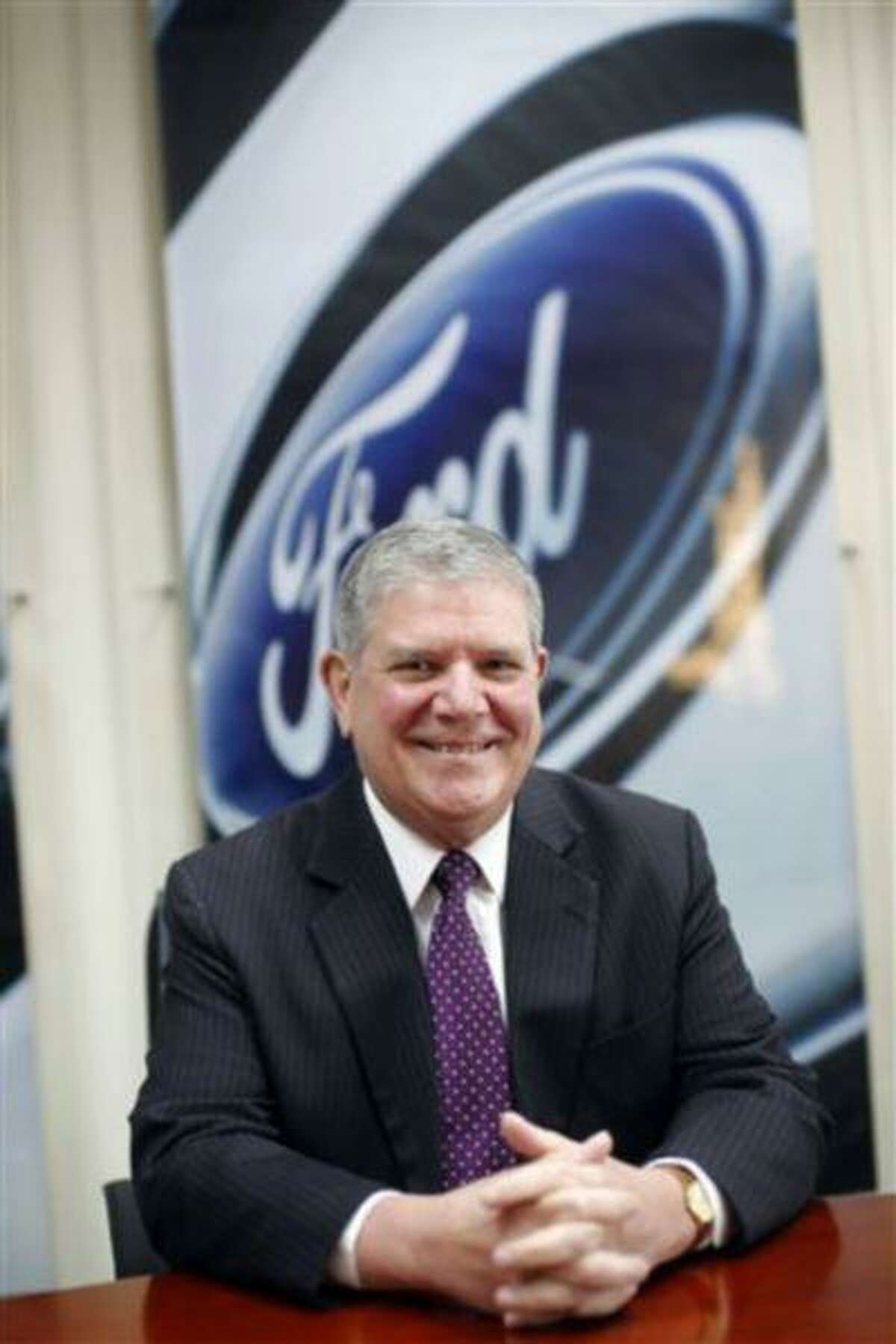 In this photo taken March 4, 2013, David Schoch, Ford Motor Company group vice president and president, Asia Pacific, poses for photos at his office in Shanghai, China. (AP Photo)