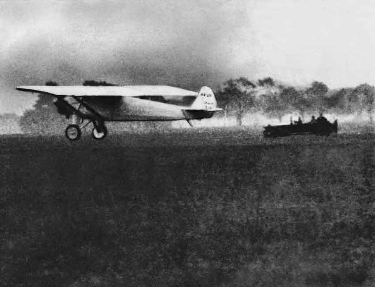 """Charles Lindbergh flies """"The Spirit of St. Louis"""" out of Roosevelt Field in New York, May 20, 1927, as he begins his flight to Paris to be the first to complete a non-stop transcontinental flight. (AP Photo)"""