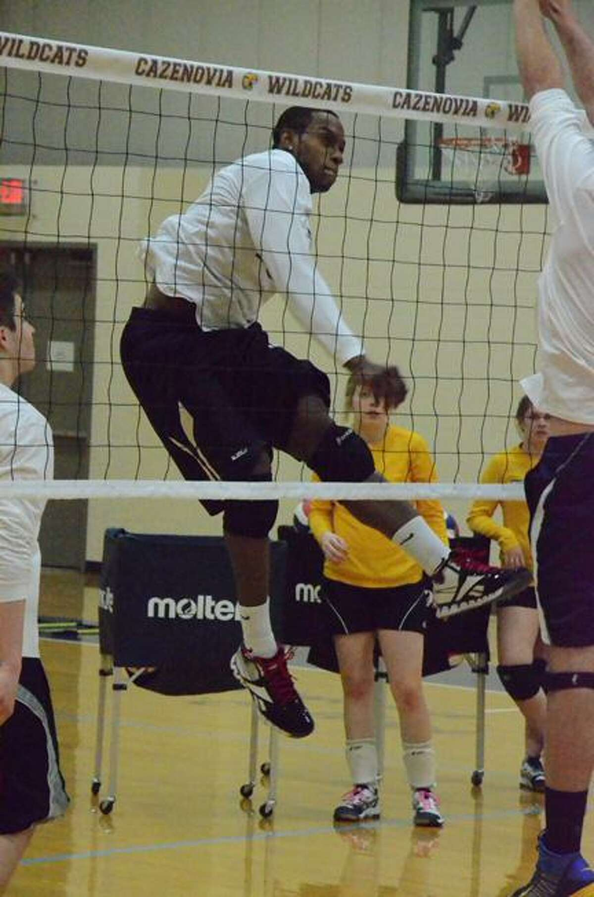 KYLE MENNIG/ONEIDA DAILY DISPATCH Cazenovia's Stanley McDaniel hits a ball during practice Monday. The senior is one of several Wildcats playing volleyball for the first time this year.