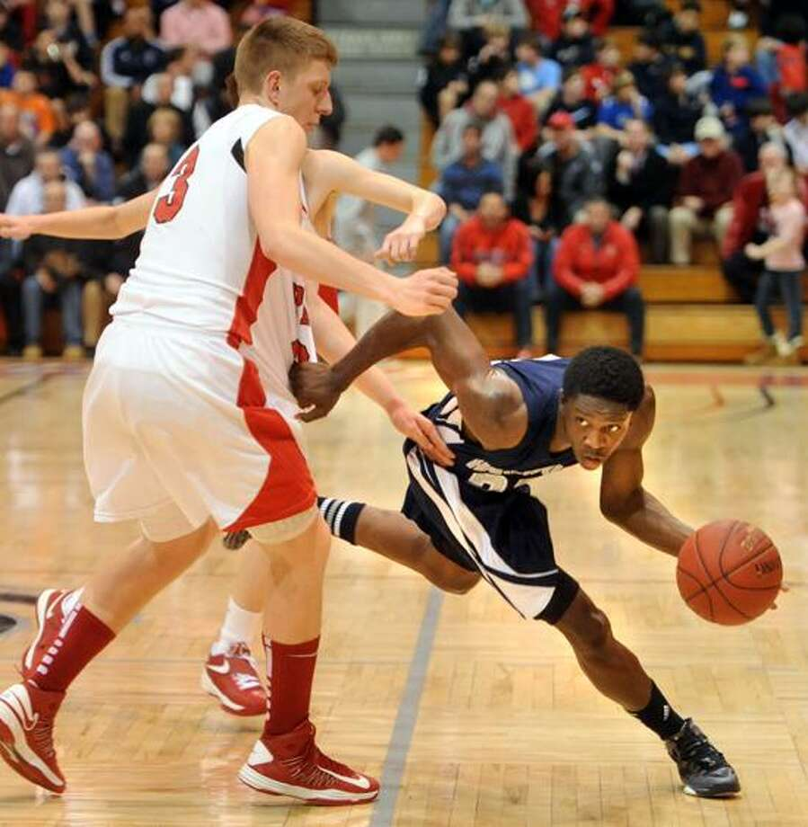 Fairfield Prep's Tim Butala tries to guard Hillhouse's Shane Christie dueing Hillhouse's win Tuesday night. Both Hillhouse and Prep won its respective games Friday.  Mara Lavitt/New Haven Register.