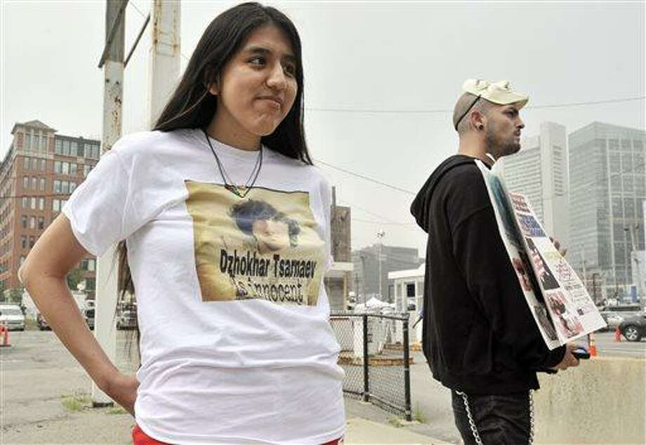 Jennifer Michio, left, from Mashantucket, Conn., and Duke La Touf, right, of Las Vegas, stand in support of Boston Marathon bombing suspect Dzhokhar Tsarnaev outside the federal courthouse prior to his arraignment Wednesday, July 10, 2013, in Boston. The April 15 attack killed three and wounded more than 260. The 19-year-old Tsarnaev has been charged with using a weapon of mass destruction, and could face the death penalty. (AP Photo/Josh Reynolds) Photo: AP / FR25426 AP
