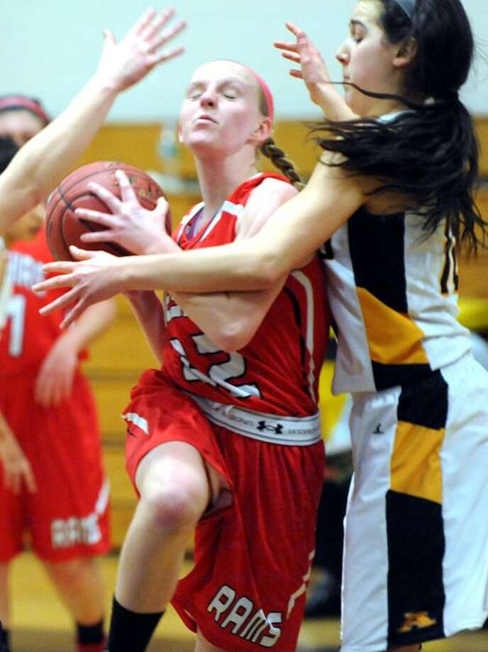Cheshire's Lily Dolyak tries to drive past Amity's Mikaila Schmitt in the second half of Friday's win for Amity over Cheshire. Photo by Arnold Gold/New Haven Register.