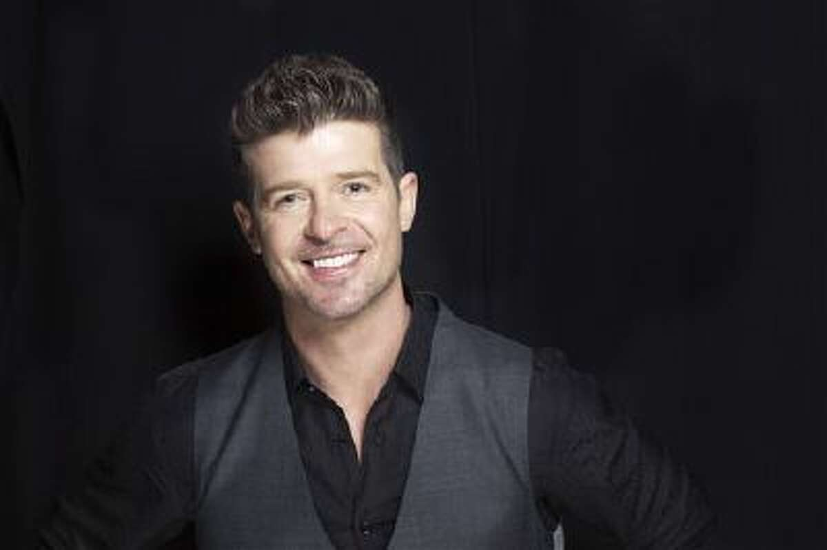 """This Aug. 1, 2013 file photo shows R&B singer-songwriter Robin Thicke in New York. Two of Marvin Gaye's children, Nona and Frankie Gaye, countersued Thicke and his collaborators on the hit song """"Blurred Lines"""" on Wednesday, Oct. 30, 2013, in Los Angeles claiming the singers improperly copied their father's hit """"Got to Give It Up."""""""