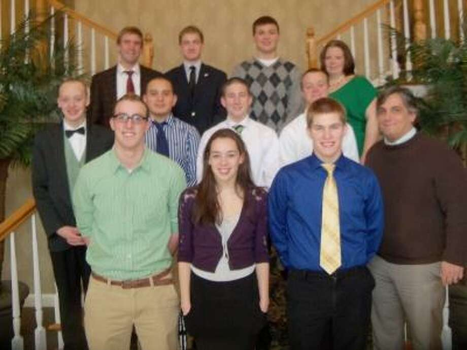 Peter Wallace/Register Citizen Torrington High School swimming and diving seniors and their coaches, along with the rest of the team, celebrated a great season with a banquet at Torrington's Cornucopia Banquet Facility. Seniors and coaches are, front row, left to right, Kevin Finn, Allison Prince, Pat Baker; second row, Chris Shea, Cort Avila, Anthony Parziale, Evan Reynolds, diving coach Mike Michaud; third row, head coach Andrew Marchand, Nick Baldwin, Tom Somers, assistant coach Erin Sullivan.