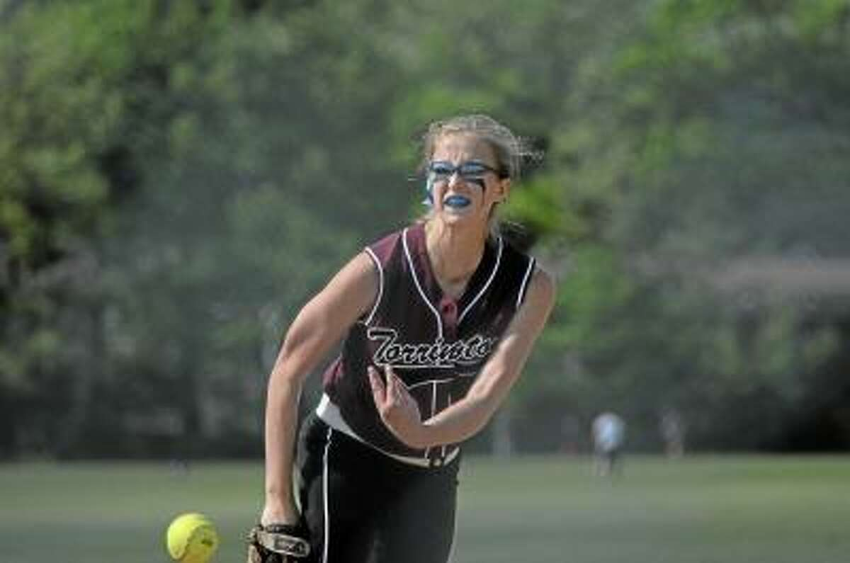Photo by Sean Meenaghan/Register Citizen Torrington's Sydney Matzko pitches in the first inning to Kennedy. She struck out 16 batters in Torrington's 2-0 win.