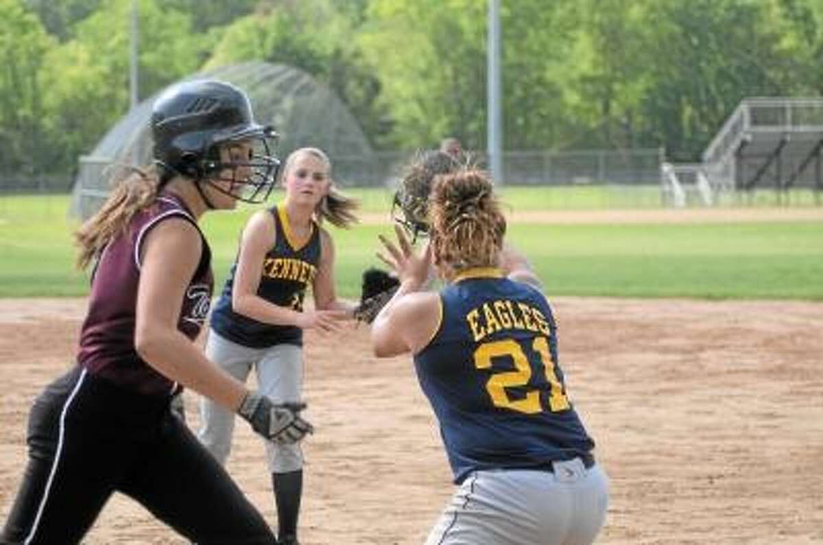 Photo by Sean Meenaghan/Register Citizen Torrington's Brittany Young attempts to beat out a bunt.