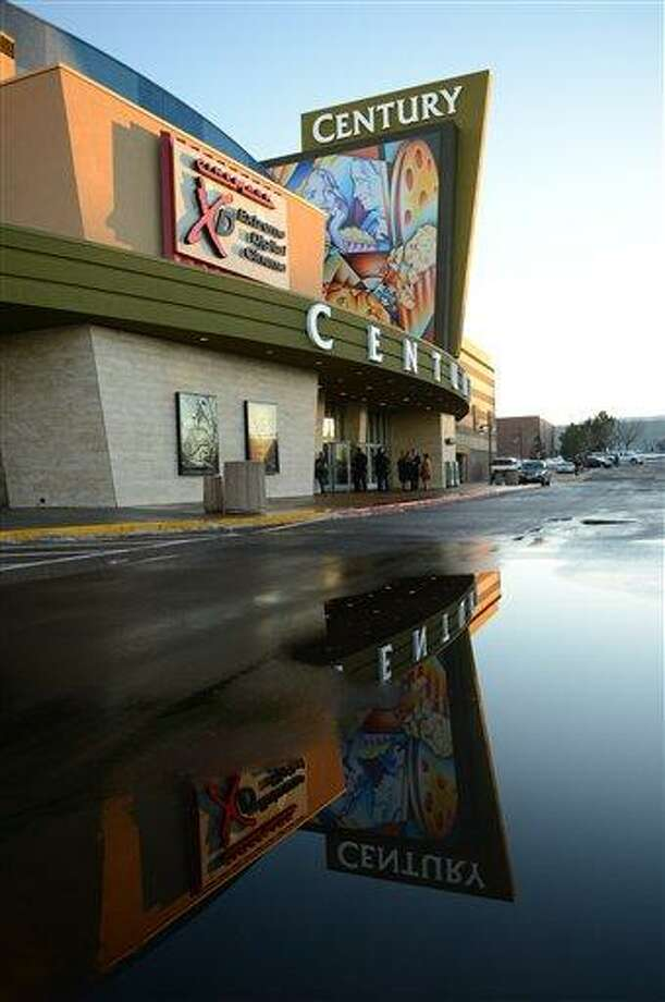 The remodeled Century Aurora cinema, formerly the Century 16, is reflected in large puddle in the parking before a reopening and remembrance ceremony Thursday, Jan. 17, 2013 in Aurora, Colo. The theater is where 12 people were killed and dozens injured in a shooting rampage last July. (AP Photo/The Denver Post, RJ Sangosti, Pool) Photo: AP / Pool Denver Post