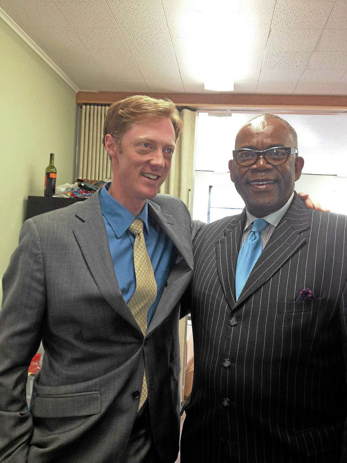 City Clerk Ron Smith, right, poses with New Haven mayoral candidate Justin Elicker.