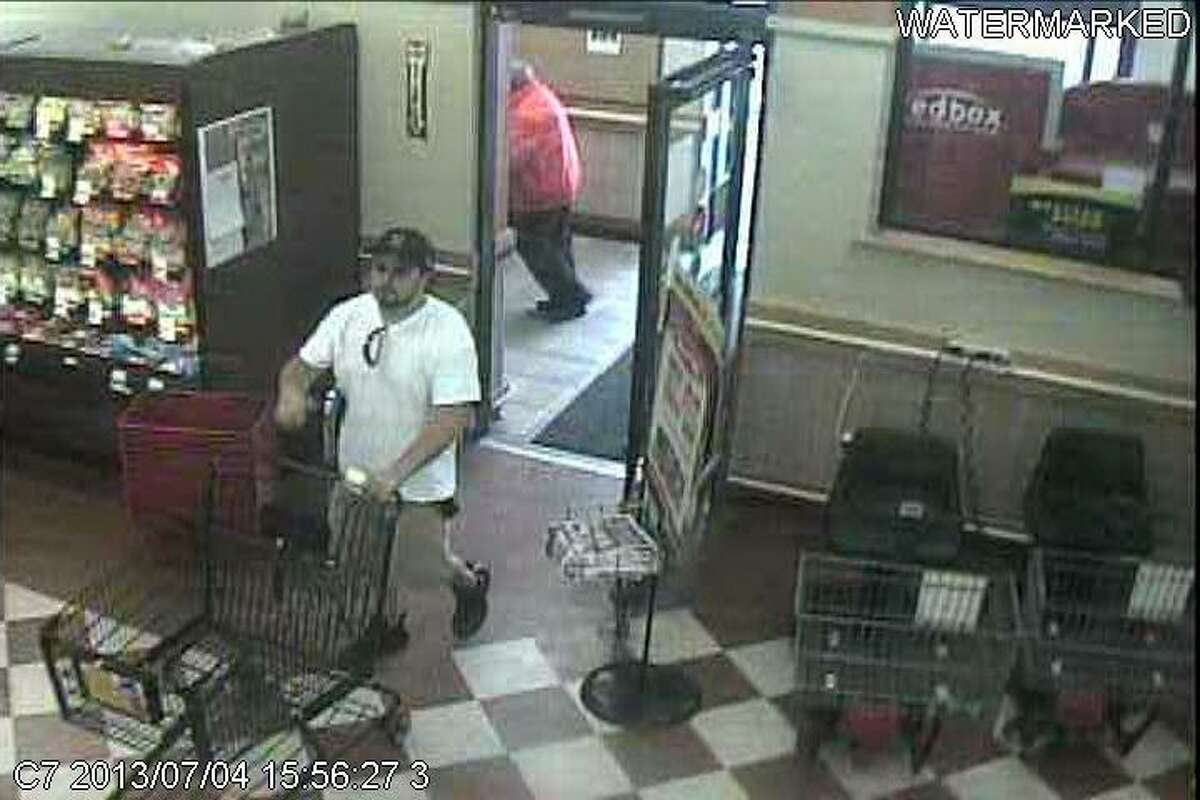 Photo provided by Sherrill City Police...Police are searching for this suspect who allegedly left the Sherrill Tops Friendly Market on July 4 without paying for a cart full of groceries.