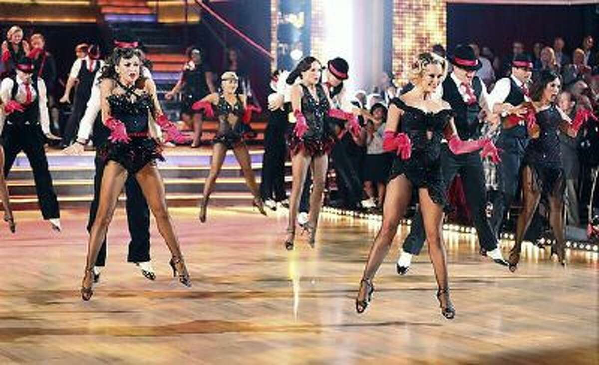 Cast members perform at the start of 'Dancing with the Stars' on Monday, September 30, 2013.