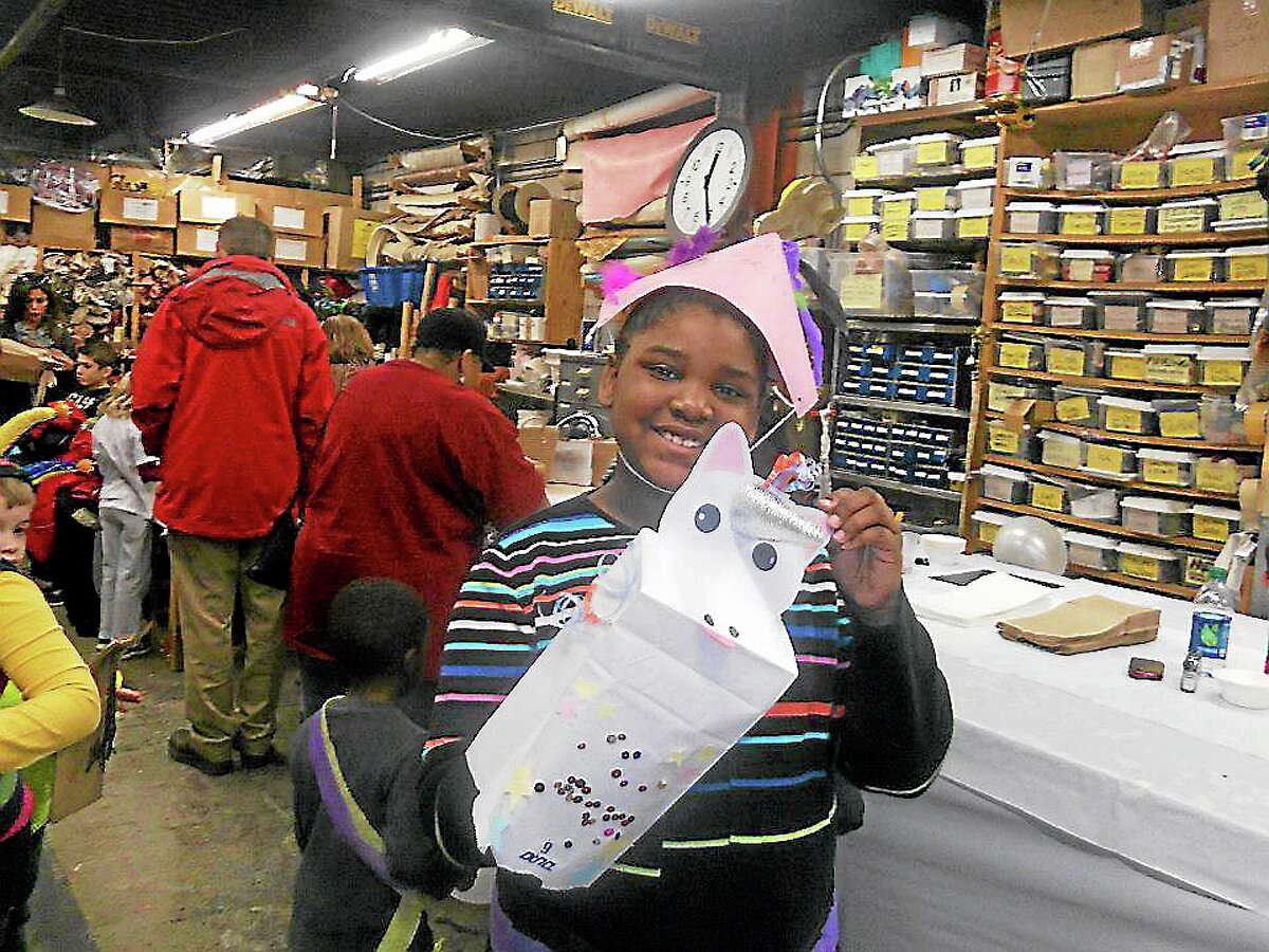 A young visitor at last year's Discovery Day at Long Wharf Theatre made himself a unicorn to take home.