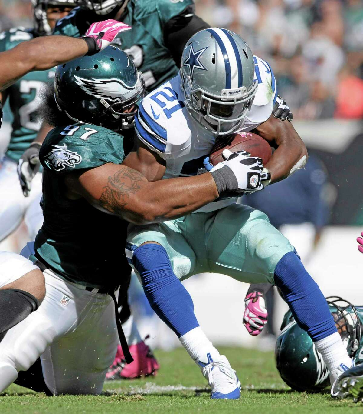 Dallas Cowboys running back Joseph Randle (21) is stopped by Eagles nose tackle Isaac Sopoaga (97) during the first half of Oct. 20's game in Philadelphia. The New England Patriots acquired Sopoaga from the Eagles Tuesday along with a sixth-round pick in 2014 for a fifth-rounder next year. The 32-year-old Sopoaga helps replace Pro Bowl nose tackle Vince Wilfork, who is out for the season.