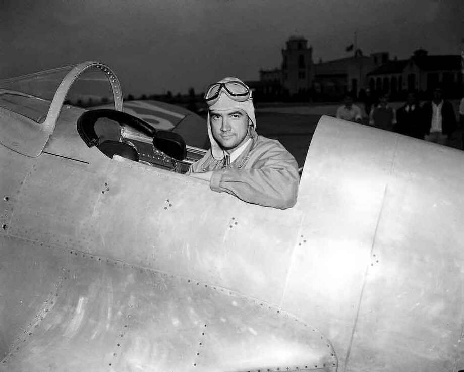 Howard Hughes, industrialist, film producer and pilot, poses in the cockpit of his new racing plane after a test flight in Los Angeles August 17, 1935.  The plane, nearly two years in construction at a cost believed to be more than $100,000, was to be piloted by Hughes in the Bendix race from Los Angeles to Cleveland. (AP Photo) Photo: AP / 1935 AP