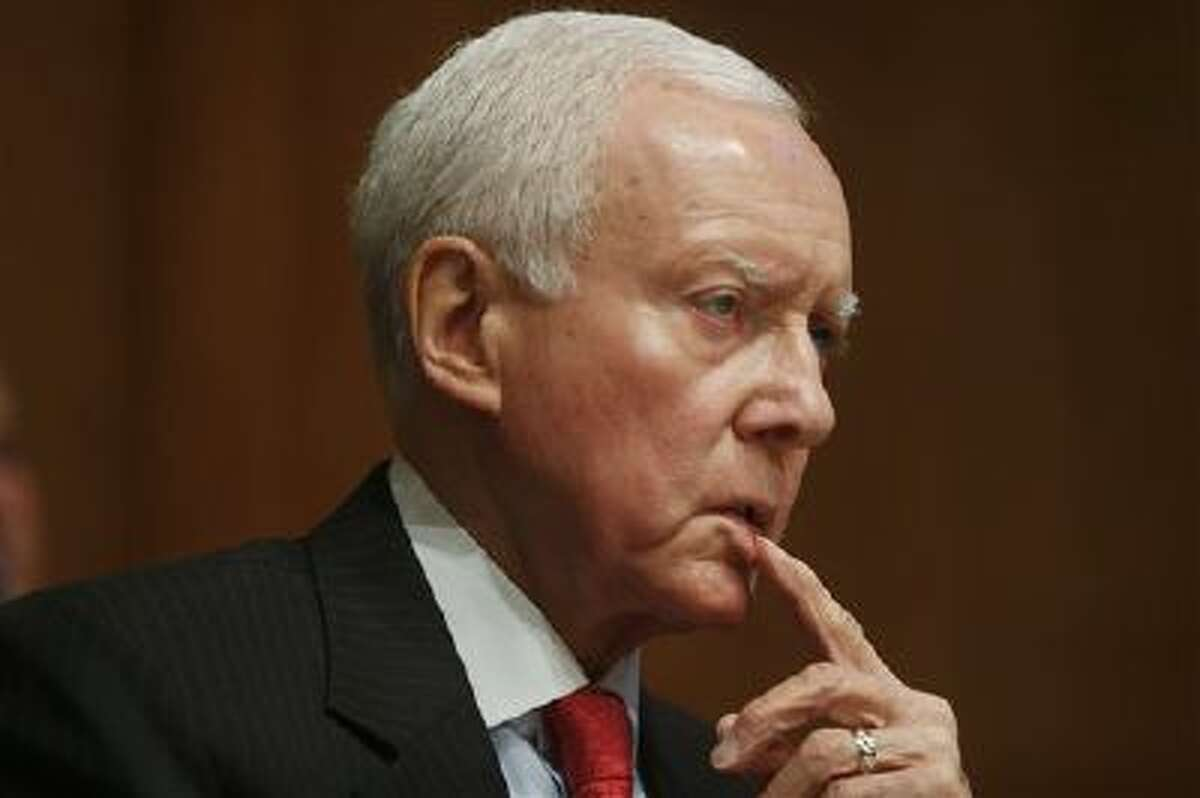 In this photo taken May 21, 2013, Senate Finance Committee ranking member, Republican Sen. Orrin Hatch of Utah, listens to testimony at the committee's hearing on the IRS's targeting of applicants for tax exempt status. (AP)