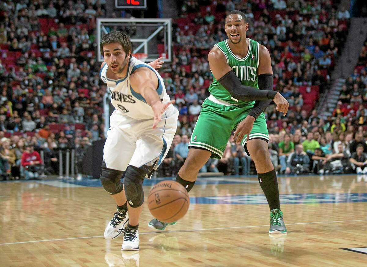 The Boston Celtics' Jared Sullinger, right, makes a pass as Minnesota Timberwolves guard Ricky Rubio defends during the first quarter of a preseason game in Montreal on Oct. 20.