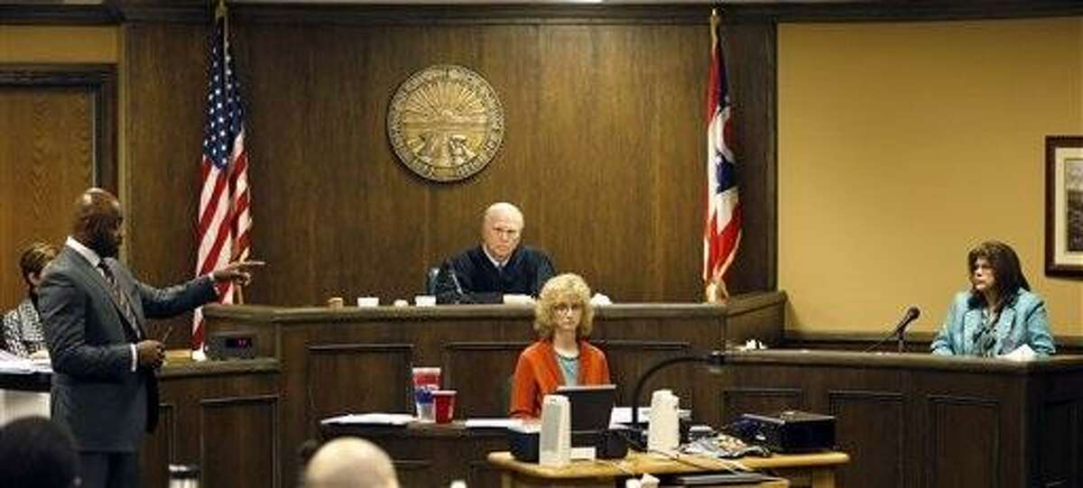 Defense attorney Walter Madison, left cross-examines states expert witness, forensic scientist Laureen Marinetta, right, as Judge Thomas Lipps, center, listens on the fourth day of the rape trial against Trent Mays, 17, and Ma'lik Richmond, 16, in juvenile court on Saturday, March 16, 2013, in Steubenville, Ohio. Mays and Richmond are accused of raping a 16-year-old West Virginia girl in August, 2012. Lipps later heard both sides closing arguments and said he would render a decision on Sunday morning, March 17. (AP Photo/Keith Srakocic, Pool)