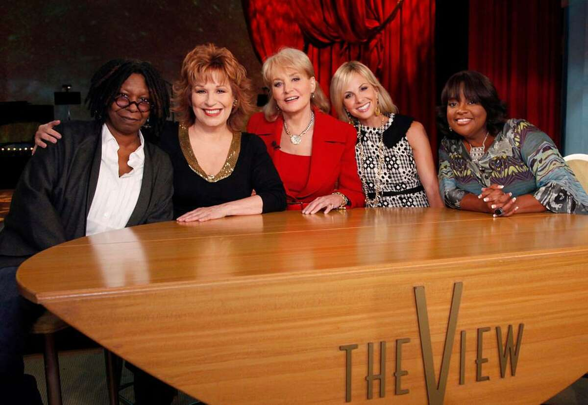 """FILE - In this file TV publicity image released by ABC, from left, Whoopi Goldberg, Joy Behar, Barbara Walters, Elizabeth Hasselbeck and Sherri Shepherd pose on the set of their daytime talk show, """"The View."""" Hasselbeck is leaving the desk at """"The View"""" for the couch on Fox News Channel's """"Fox & Friends."""" The news network said Tuesday, July 9, 2013, that Hasselbeck, who has been on Barbara Walters' syndicated daytime show for a decade, will join co-anchors Steve Doocy and Brian Kilmeade on Fox's morning show in September. (AP Photo/ABC, Heidi Gutman, File)"""