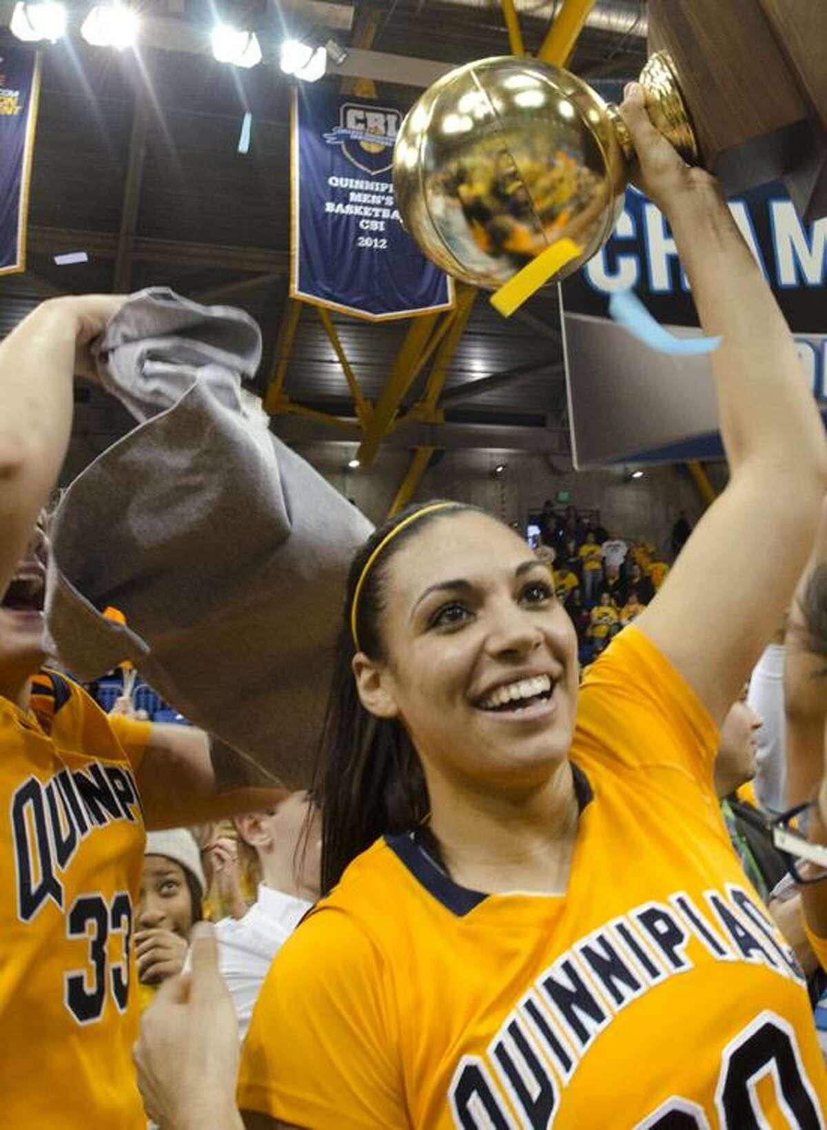 Sports Quinnipiac celebrates. MVO , Brittany McQuaine holds the trophy. Melanie Stengel/Register