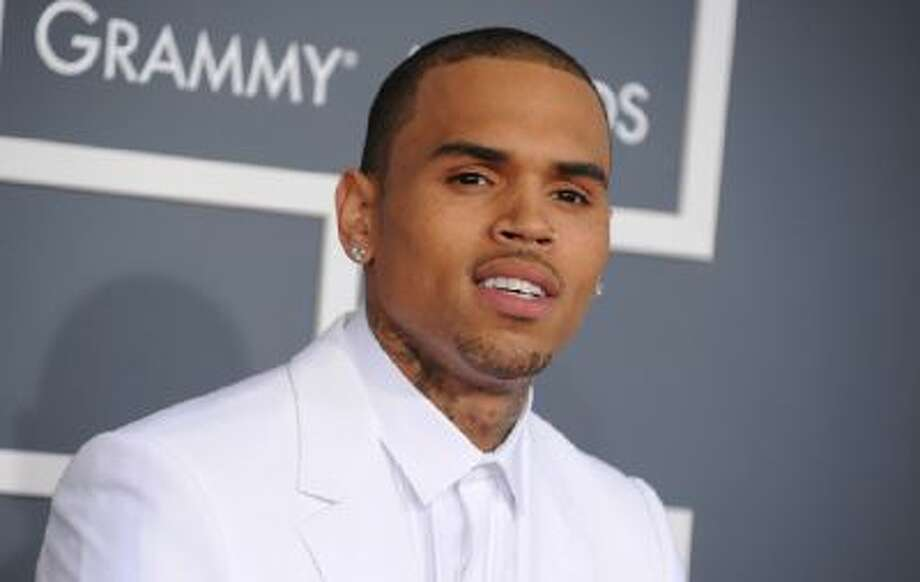 In this Feb. 10, 2013 photo, Chris Brown arrives at the 55th annual Grammy Awards, in Los Angeles.