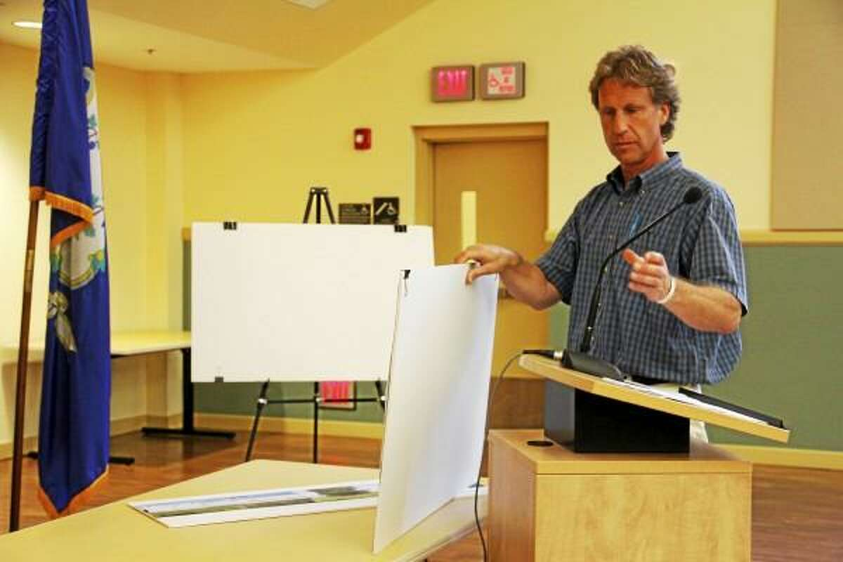 Vice President of Borghesi Building & Gary Capitanio puts together a building plan as he prepares to present a schematic for a 18,900 square-foot addition and parking lot at 37 Technology Park Dr. that will belong to Wittmann Battenfeld, a robotics company, on Wednesday, July 10.