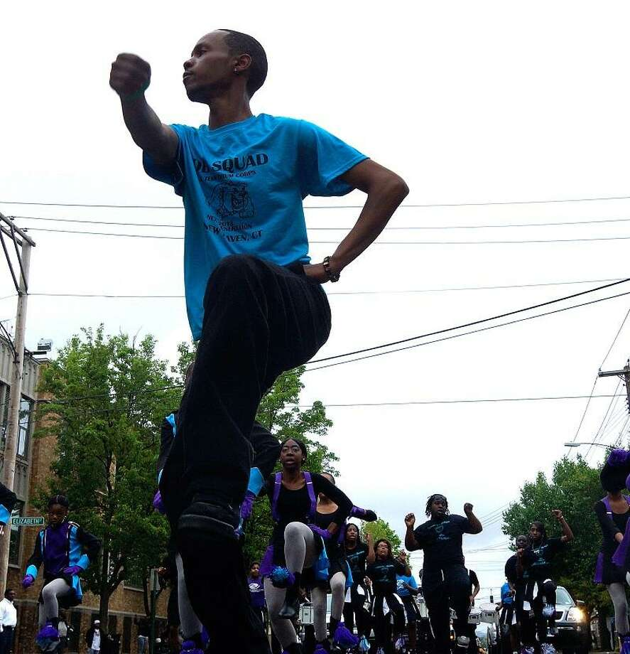 """New Haven-- Ryshon Menafee leads the """"Mob Squad""""  in the Freddie Fixer Parade down Dixwell Ave from Hamden to New Haven Sunday. Photo-Peter Casolino/Register <a href=""""mailto:pcasolino@newhavenregister.com"""">pcasolino@newhavenregister.com</a>"""