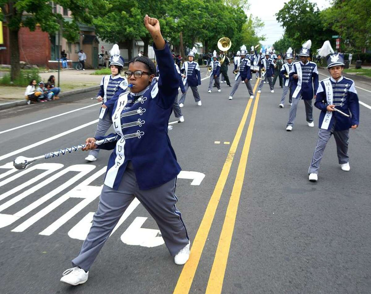 New Haven-- Julianne Bell leads the Hillhouse Marching Band in the Freddie Fixer Parade down Dixwell Ave from Hamden to New Haven Sunday. Photo-Peter Casolino/Register pcasolino@newhavenregister.com