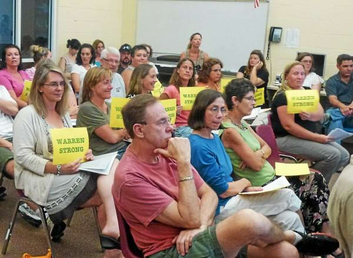 Ryan Flynn-Register Citizen - A crowd of parents attend the Region 6 schools meeting to address concerns over a blended classroom at Warren School in the fall.