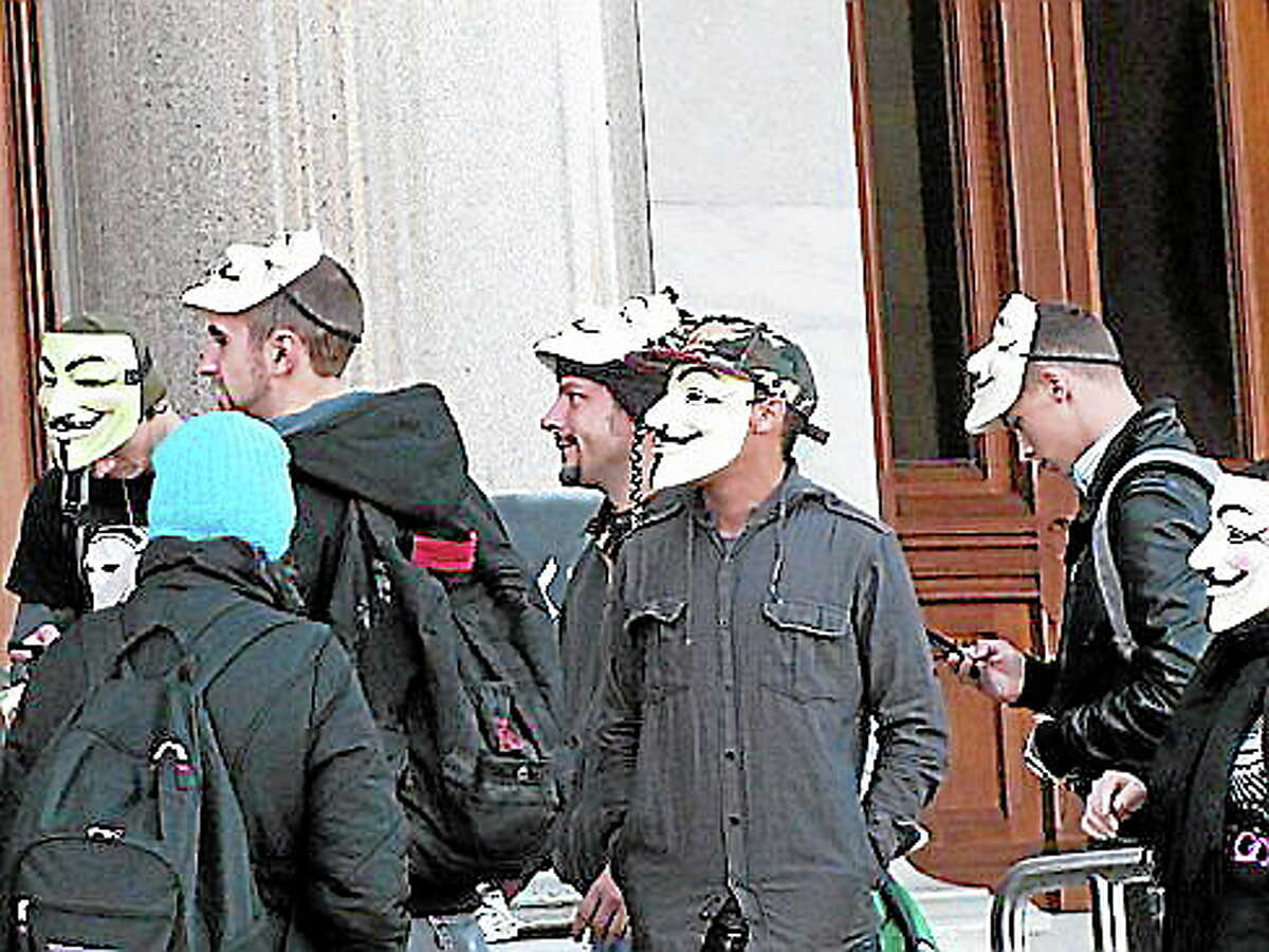 Protesters on the Capitol steps. Hugh McQuaid/CT NewsJunkie