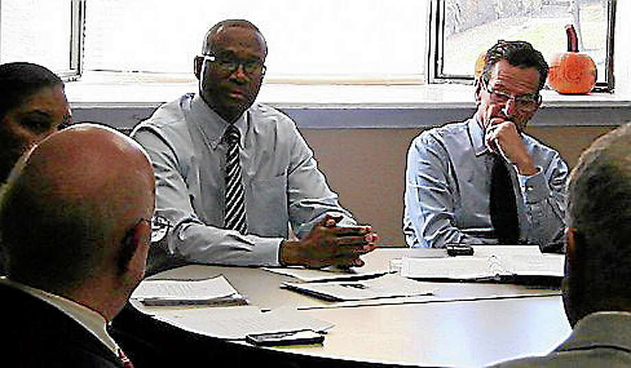 Andrew Woods of Hartford Communities That Care and Gov. Dannel P. Malloy Tuesday morning discuss crime prevention. Christine Stuart/CT NewsJunkie Photo: Journal Register Co.