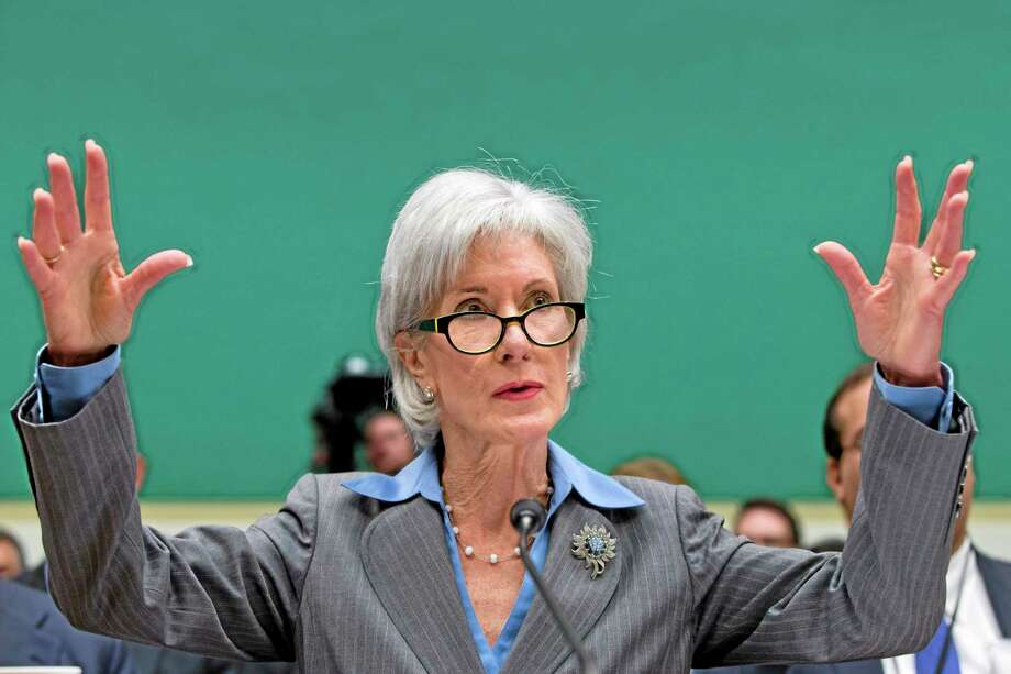 Health and Human Services Secretary Kathleen Sebelius gestures while testifying on Capitol Hill in Washington, Wednesday, Oct. 30, 2013, before the House Energy and Commerce Committee hearing on the difficulties plaguing the implementation of the Affordable Care Act. The Obama Administration claims the botched rollout was the result of contractors failing to live up to expectations – not bad management at HHS. As the public face of President Barack Obama's signature health care program, Sec. Sebelius has become the target for attacks over its botched rollout with Republicans, and even some Democrats, calling for her to resign. (AP Photo/J. Scott Applewhite) Photo: AP / AP