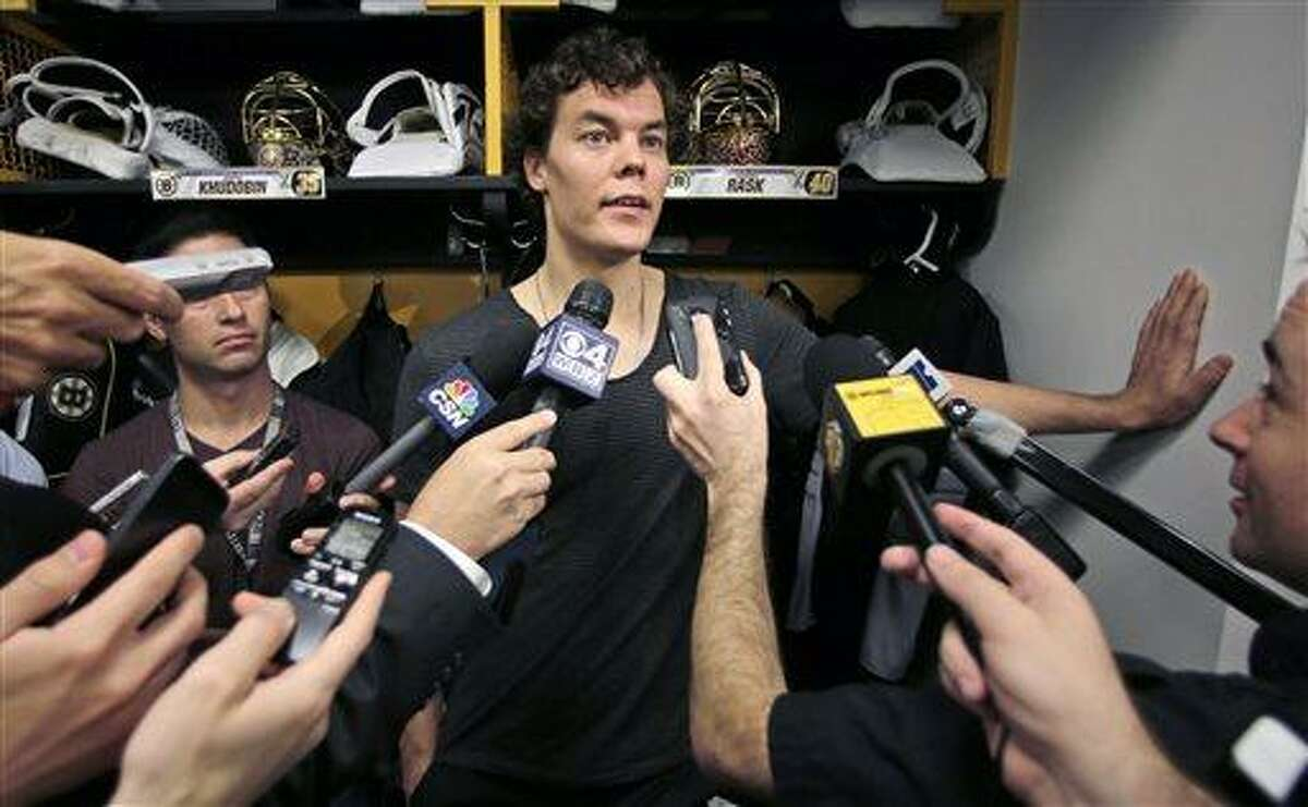 Boston Bruins goalie Tuukka Rask, of Finland, speaks to the media in the team locker room Wednesday, June 26, 2013, in Boston, two days after losing to the Chicago Blackhawks in the Stanley Cup Final. (AP Photo/Charles Krupa)