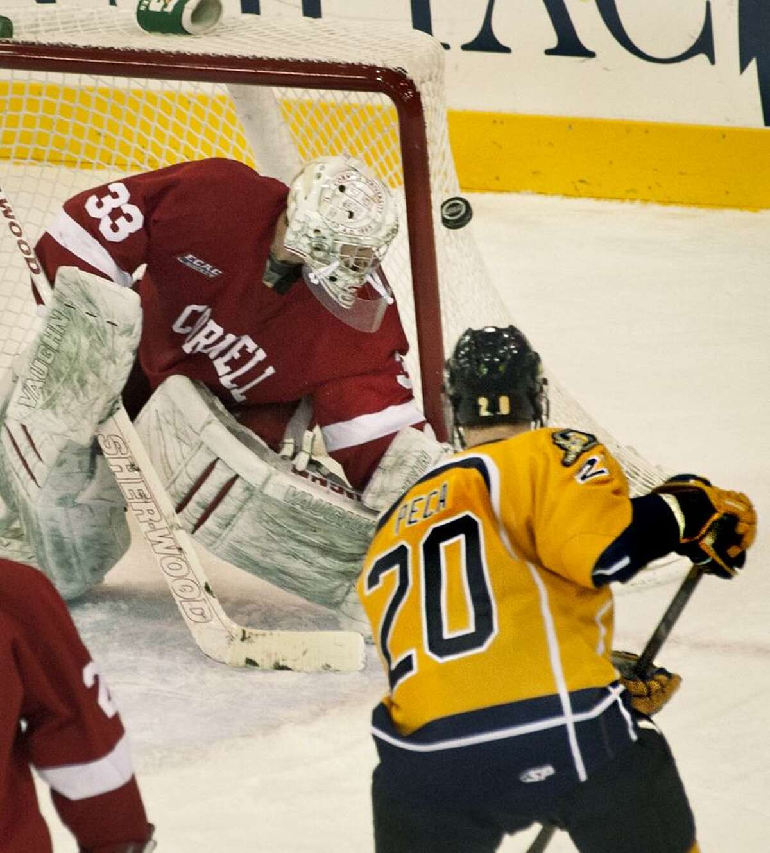 Sports-Quinnipiac vs. Cornell Hockey--Cornell goalie Andy Iles, watches a shot by Quinnipiac's Matthew Peca bounce off the post in 2nd period action. Melanie Stengel/Register