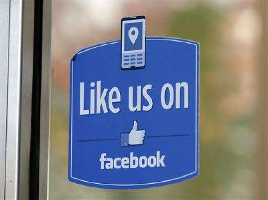 "A sign with Facebook's ""Like"" logo is posted at Facebook headquarters in Menlo Park, Calif. Photo: AP / AP"