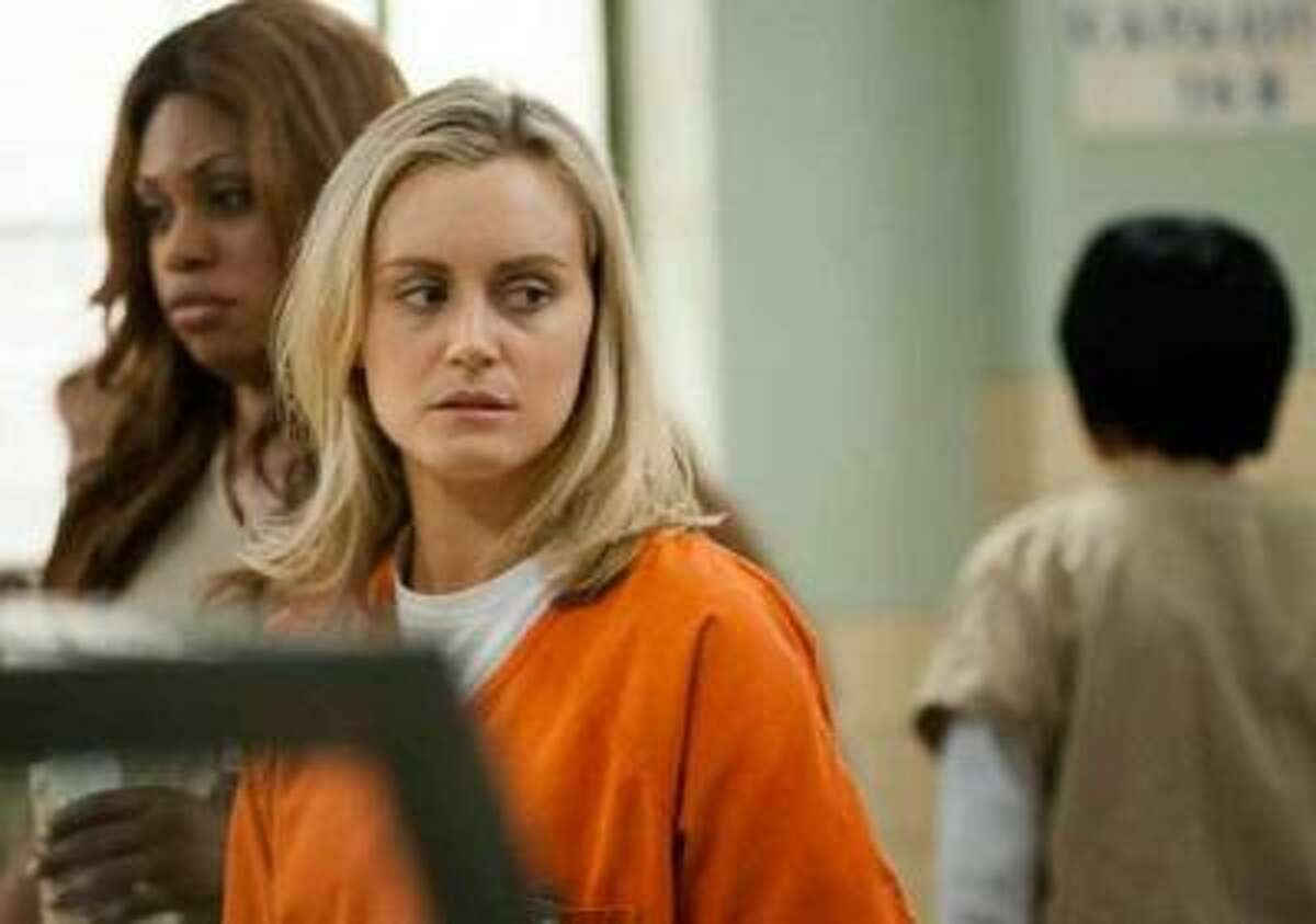 """LIONSGATE TELEVISION A foolish choice made years ago lands Piper Chapman (played by Taylor Schilling) in prison in """"Orange is the New Black,"""" an Netflix original TV series."""
