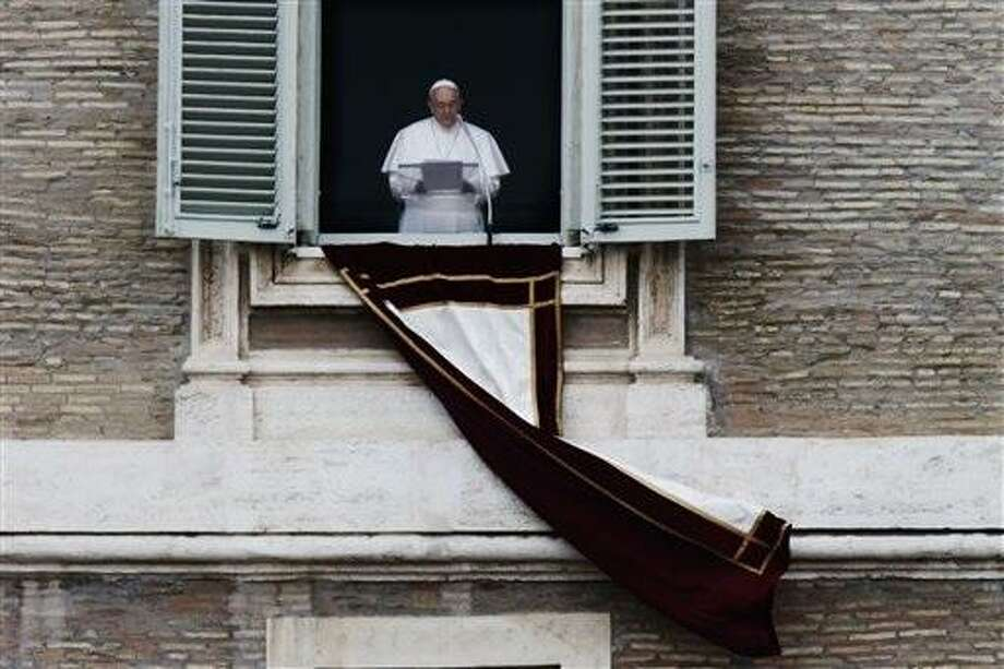 Pope Francis recites the Angelus prayer to the crowd in St. Peter's Square at the Vatican, Sunday, March 17, 2013.(AP Photo/Dmitry Lovetsky) Photo: AP / AP