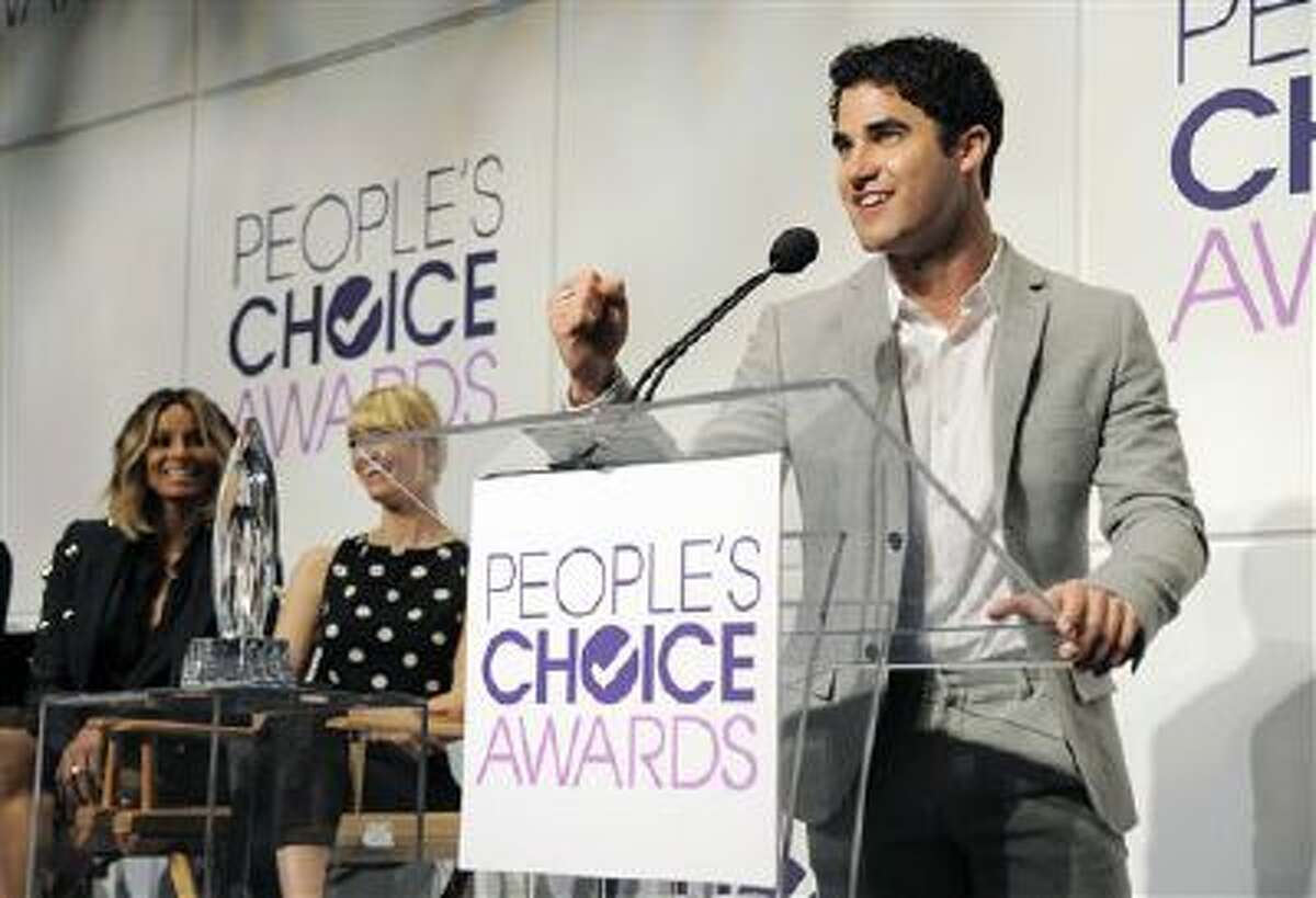 Presenter Darren Criss, right, announces nominations for the 40th Annual People's Choice Awards at The Paley Center for Media on Tuesday, Nov. 5, 2013 in Beverly Hills, Calif. Looking on at left are fellow presenters Ciara and Beth Behrs. The show will be held on Jan. 8, 2014 at the Nokia Theater L.A. Live in Los Angeles.