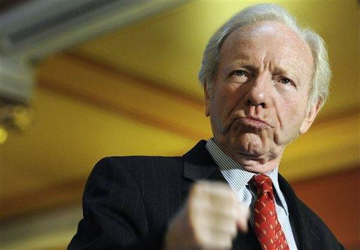 Sen. Joseph Lieberman, I-Conn., gestures with his fist during a news conference at the state capitol in Hartford, Conn., Monday, Dec. 10, 2012. Lieberman is kicking off a farewell tour with words of thanks for the people of Connecticut and warnings about dysfunction in Washington. Lieberman is retiring at the end of the session on Jan. 3 after 24 years in the Senate. (AP Photo/Jessica Hill)