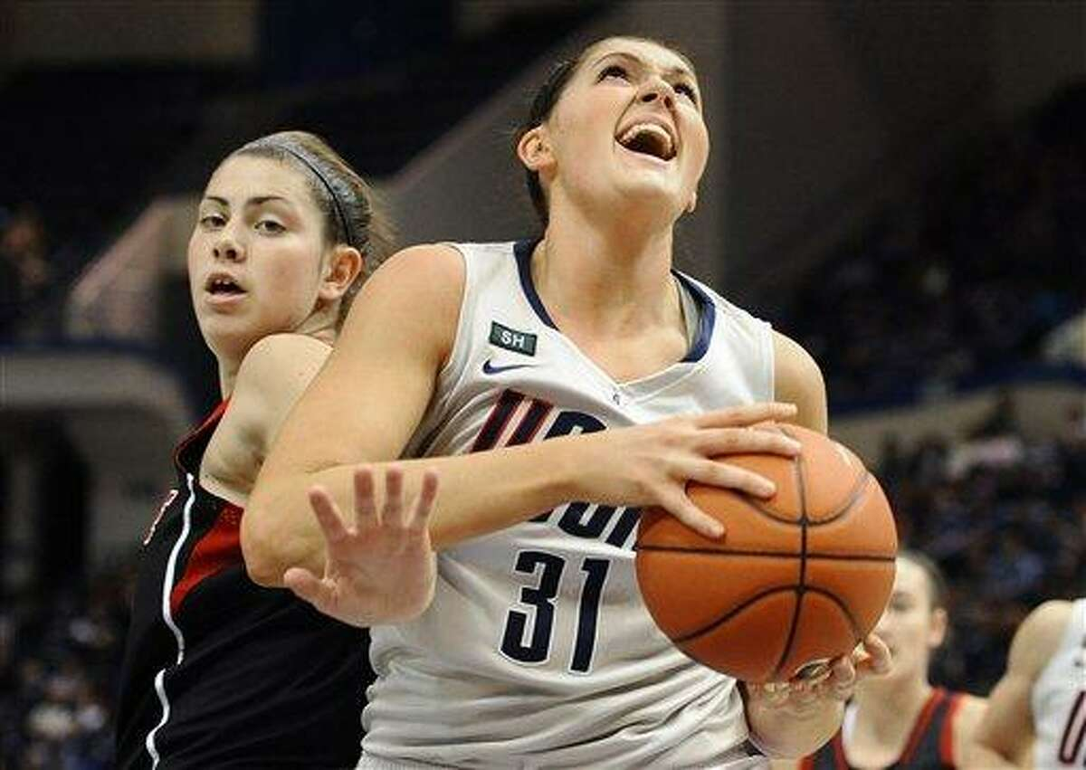 Connecticut's Stefanie Dolson, left, is guarded by Louisville's Sara Hammond, left, during the first half of an NCAA college basketball game in Hartford, Conn., Tuesday, Jan. 15, 2013. (AP Photo/Jessica Hill)