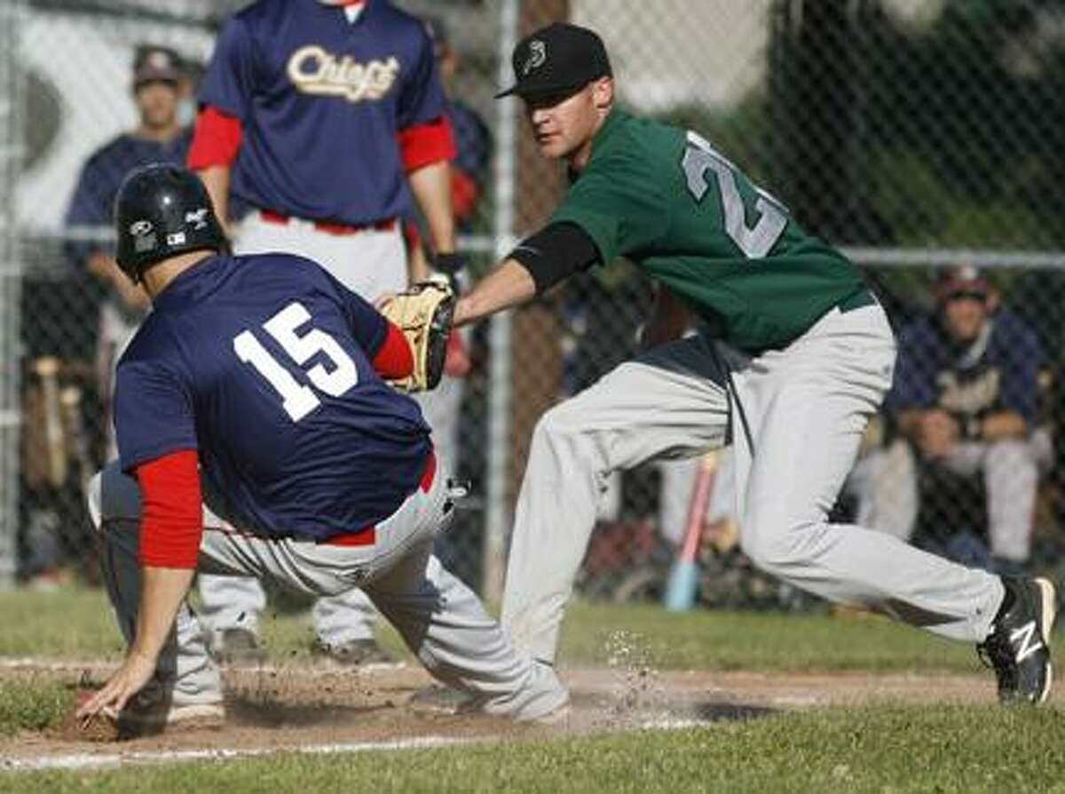 JOHN HAEGER @OneidaPhoto on TwitterNate Eastman (20) tags out a runner during last year's home opener for the Sherrill Silversmiths.