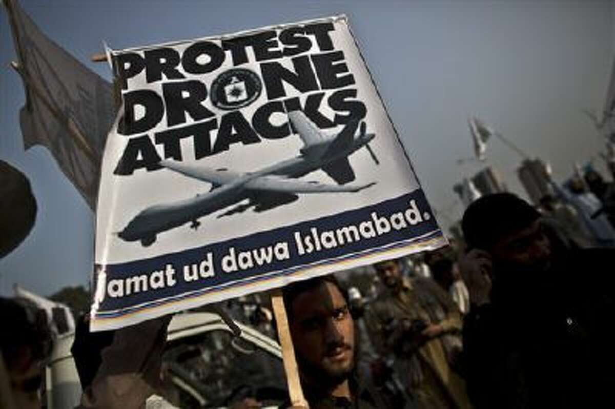 A supporter of the Pakistani religious party Jamaat-u-Dawa holds up a banner during a rally to condemn U.S. drone attacks in Pakistan.