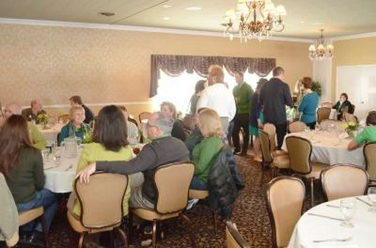 """Kate Hartman/Register Citizen. Attendees enjoyed the live music and drinks at the Center for Cancer Care Fund's """"Celebration of St. Patrick's Day"""" Fundraiser at P.Sam's."""