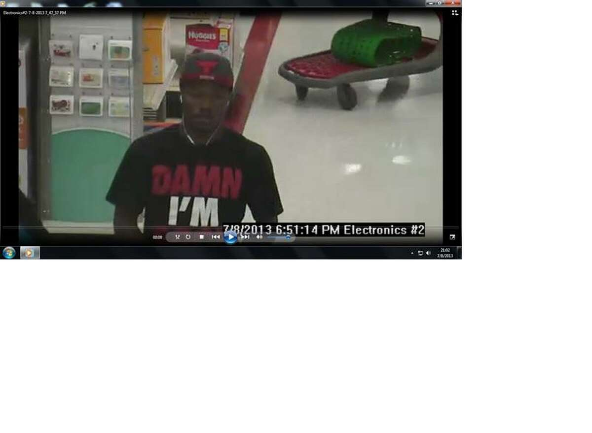 Police are looking for this man, shown on Target surveillance camera using a stolen credit card.