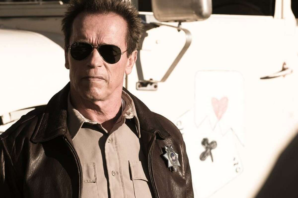 """Merrick Morton/Lionsgate photo: Arnold Schwarzenegger climbs back in the saddle as Sheriff Ray Owens in """"The Last Stand."""""""