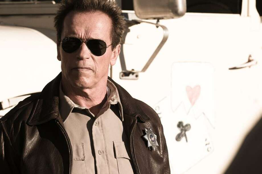 """Merrick Morton/Lionsgate photo: Arnold Schwarzenegger climbs back in the saddle as Sheriff Ray Owens in """"The Last Stand."""" Photo: AP / AP2011"""