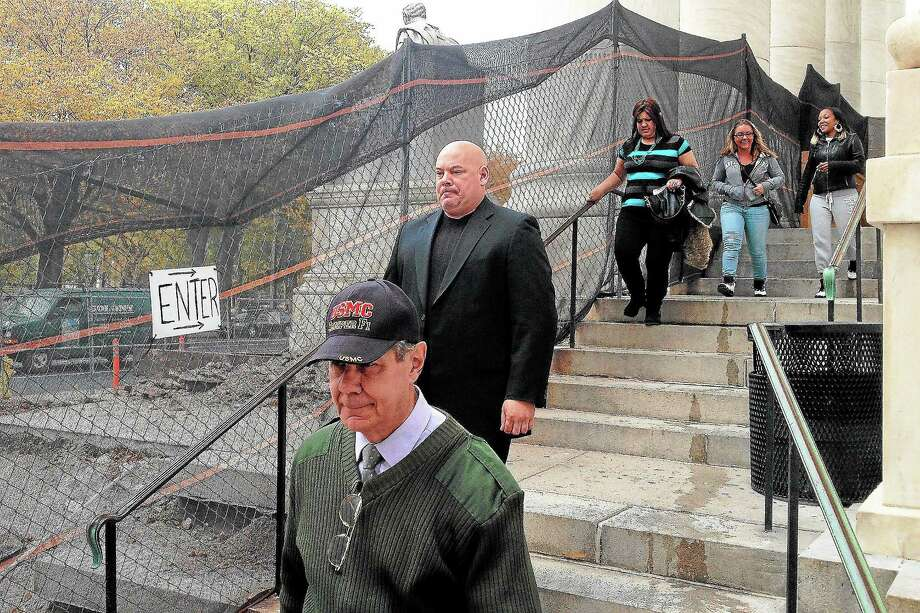 Angelo Appi Jr., rear, follows his father, Angelo Appi Sr., foreground, out of New Haven Superior Court in New haven Wednesday after pleading not guilty to a breach of peace charge. Photo: Evan Lips — New Haven Register