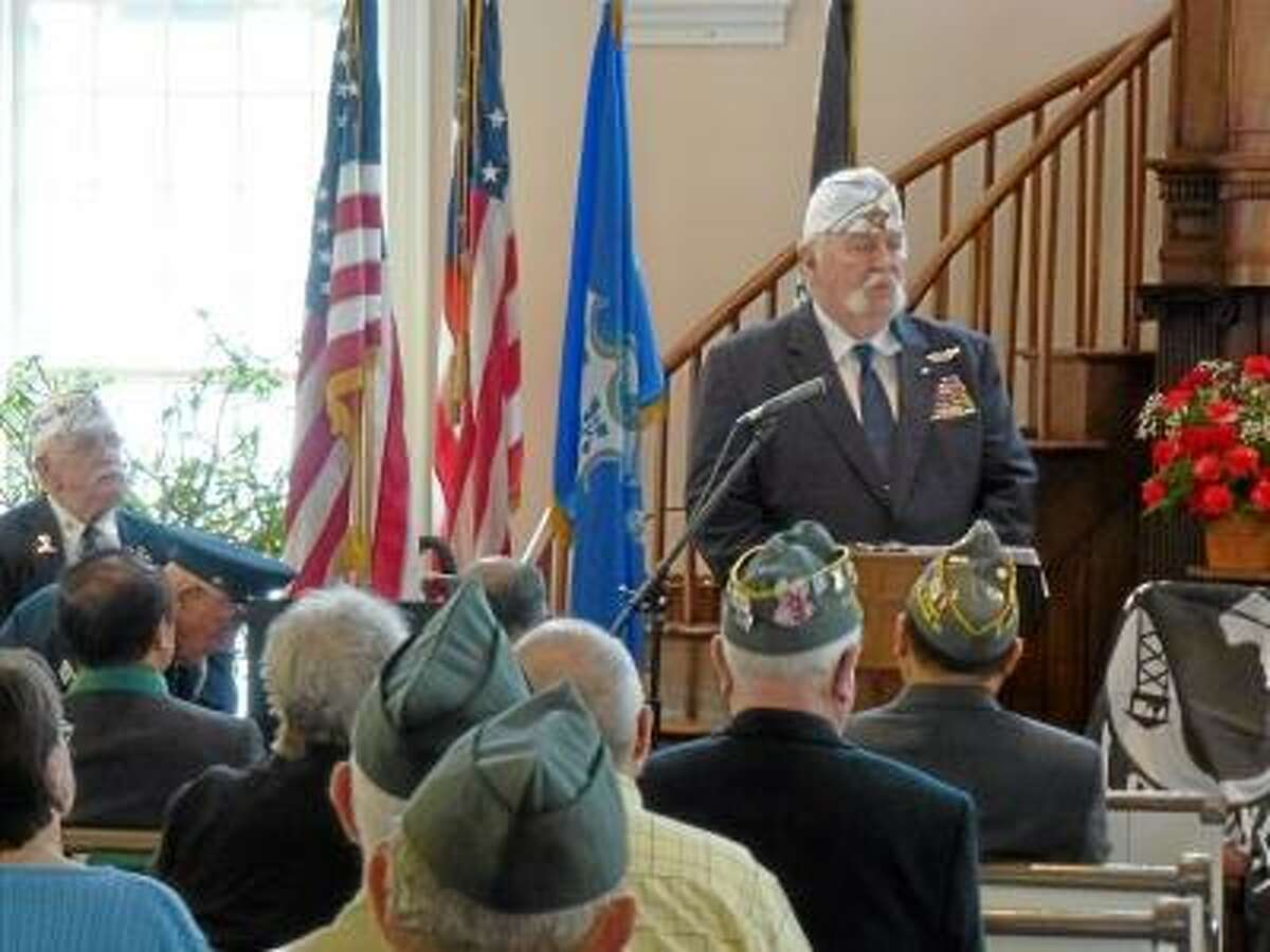 Ryan Flynn/Register Citizen - State AMVETS Commander John Harrison, a retired captain of the U.S. Air Force, gave an emotional speech about AMVETS and the group's mission.